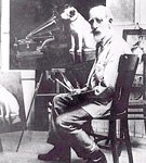 "Francis Bauraud at work on a ""His Master's Voice painting"". Another finished work at his feet."