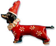 Vienna Bronze dachshund dog dressed as a clown.