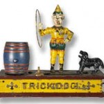 Hubley trick dog cast iron money box.