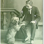 Edwardian chap with his delightful scruffy terrier in a photographer's studio.