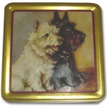 Cake tin featuring a Scottish and West Highland terrier lithograph by Lucy Dawson.