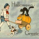 Cute old postcard! Boy and his wagon filled with large Jack-o'-lanterns with a black cat atop and a scared little puppy dog.