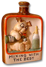 Ceramic whisky bottle with Bonzo sampling the best!