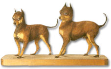 Taxidermy Black and Tan Terriers.