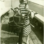 old sea dog steers boat